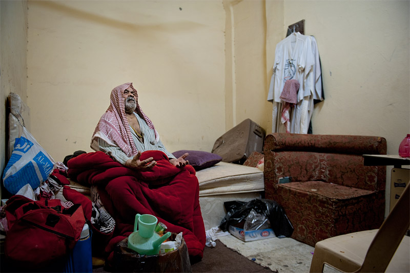 Hasawi (Kuwait). A Bedoon blind man living in a small room in a poor suburb of Kuwait City. The man has no relatives and he is helped by some Bedoon neighbour. He can't receive any medical care because Bedoon don't have the right to access to public hospitals. They have to pay for private hospitals but even in this case they are treated only with drugs of low quality. There are several cases of deaths between Bedoon patients who were denied passports to get special medications abroad.